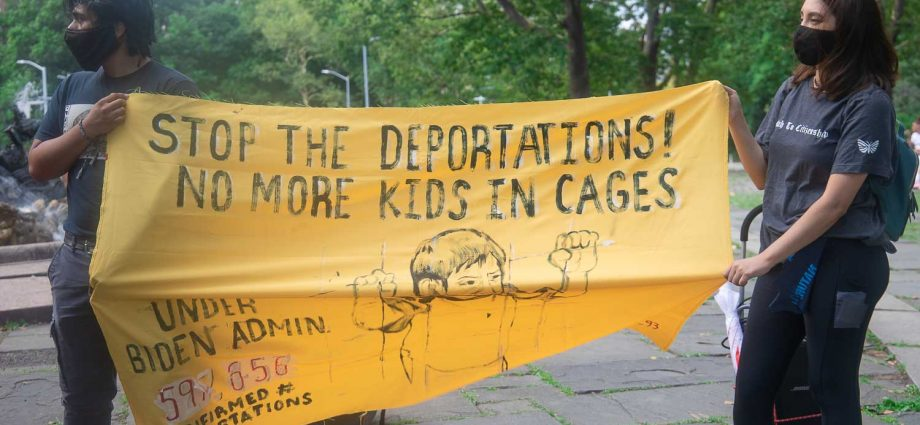 """Saturday, July 10, 2021. New York City – On Saturday, July 10, 2021, the organization Autonomous Brown Berets Of NYC held marches in the boroughs of Queens, Bronx and Brooklyn, in New York City. The demonstrations were to denounce the 600,000 deportations and expulsions of undocumented immigrants by Joe Biden and Kamala Harris. THIS PHOTO: People at Grand Army Plaza, Brooklyn. The Banner reads, """"Stop the deportations! No more kids in cages. Under Biden Admin. 597,656 confirmed # of deportations (last updated on Thursday, June 24, 2021). Photo by Javier Soriano/JavierSoriano.com"""