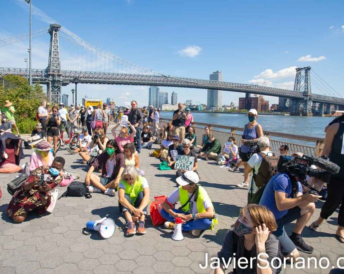 """Saturday, September 11, 2021. Manhattan, New York City - The organization East River Park ACTION held a demonstration in East River Park. They say, """"New York City will demolish our big, beloved park on the unwealthy side of the Lower East Side and East Village. Everything must go–shady lawns, picnic areas, ballfields, running track, amphitheater, the compost yard, historic buildings, and 1,000 trees."""" Photo by Javier Soriano/www.JavierSoriano.com"""